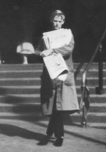 Michael Binney at age 17 selling papers on the steps of the station